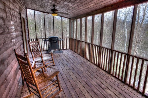 Deck overlooking woods with Gas Grill