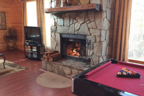 Stone Fireplace + Pool Table
