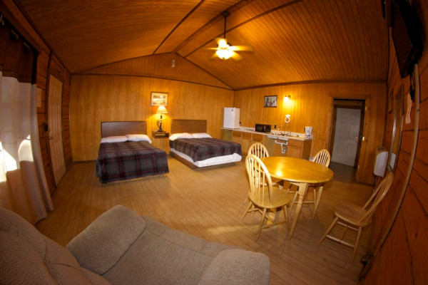 Cabin Interior - 2 beds dining table and kitchenette