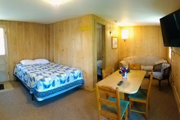 Cottage 11 has a full bed in the living room to sleep 4
