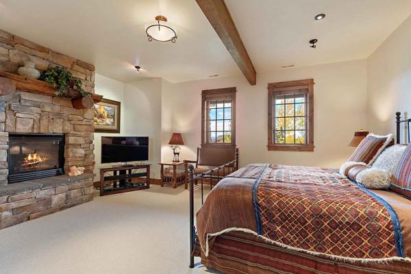 Teton Elk Cabin Bedroom with Fireplace