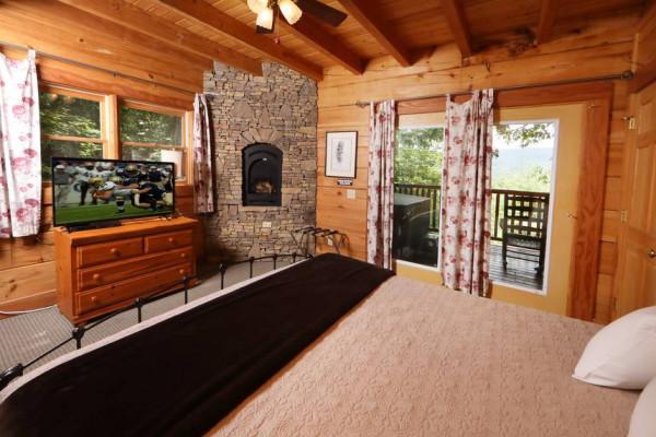 Main Floor King & Fireplace