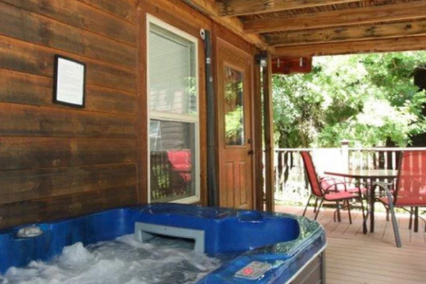 Covered porch with seating and private hot tub